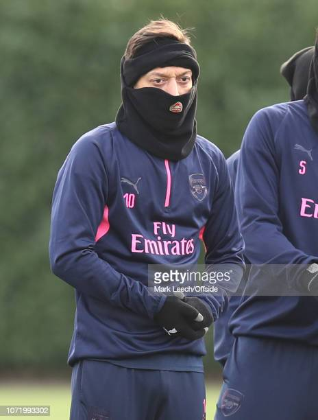 Mesut Ozil keeping his head warm during the Arsenal Training Session at London Colney on December 12, 2018 in St Albans, England.