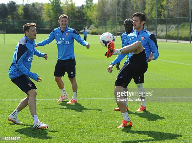 Mesut Ozil, Kim Kallstrom and Olivier Giroud of Arsenal during a training session at London Colney on May 3, 2014 in St Albans, England.
