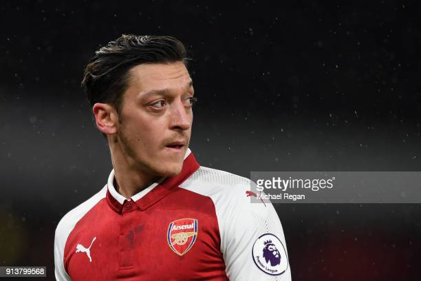 Mesut Ozil looks on during the Premier League match between Arsenal and Everton at Emirates Stadium on February 3 2018 in London England