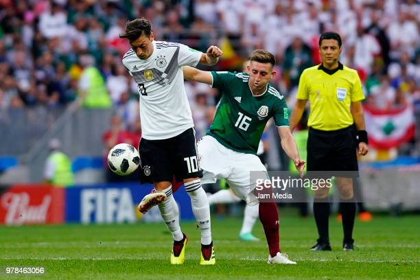 Mesut Ozil of Alemania and Hector Herrera of Mexico fight for the ball during the 2018 FIFA World Cup Russia group F match between Germany and Mexico...