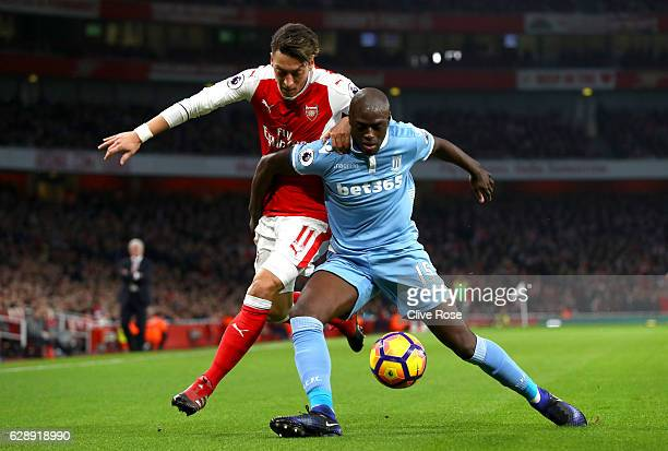 Mesut Ozil of Arsenal and Bruno Martins Indi of Stoke City battle for possession during the Premier League match between Arsenal and Stoke City at...