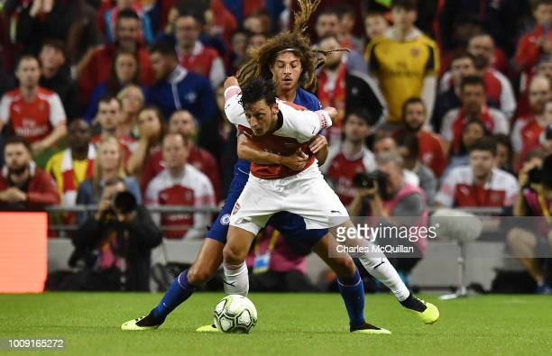 Mesut Ozil of Arsenal and Ethan Ampadu of Chelsea during the Preseason friendly International Champions Cup game between Arsenal and Chelsea at Aviva...