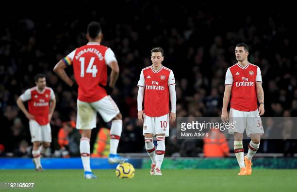 Mesut Ozil of Arsenal and Granit Xhaka of Arsenal are looking dejected after Neal Maupay of Brighton scored during the Premier League match between...