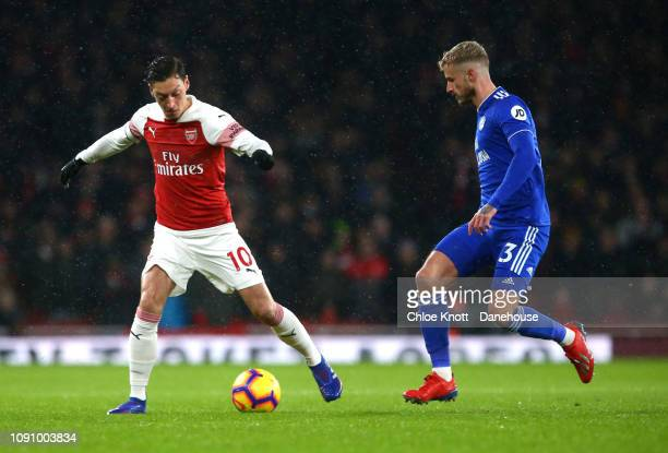 Mesut Ozil of Arsenal and Joe Bennett of Cardiff City FC in action during the Premier League match between Arsenal FC and Cardiff City at The...