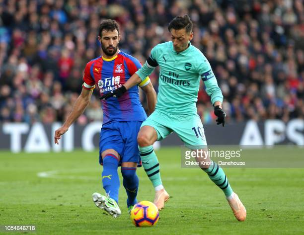 Mesut Ozil of Arsenal and Luka Milivojevic of Crystal Palace during the Premier League match between Crystal Palace and Arsenal FC at Selhurst Park...