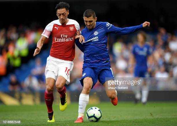 Mesut Ozil of Arsenal and Mateo Kovacic of Chelsea battle for the ball during the Premier League match between Chelsea FC and Arsenal FC at Stamford...