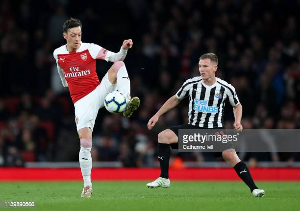 Mesut Ozil of Arsenal and Matt Ritchie of Newcastle United during the Premier League match between Arsenal FC and Newcastle United at Emirates...