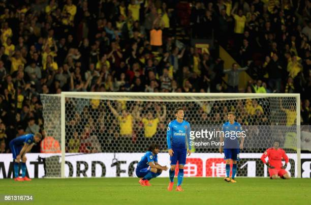 Mesut Ozil of Arsenal and team mates look dejected as Tom Cleverley of Watford scores their second goal during the Premier League match between...