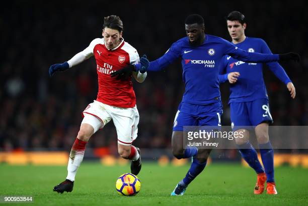 Mesut Ozil of Arsenal and Tiemoue Bakayoko of Chelsea battle for possession during the Premier League match between Arsenal and Chelsea at Emirates...
