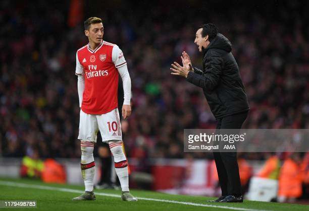Mesut Ozil of Arsenal and Unai Emery the head coach / manager of Arsenal during the Premier League match between Arsenal FC and Wolverhampton...