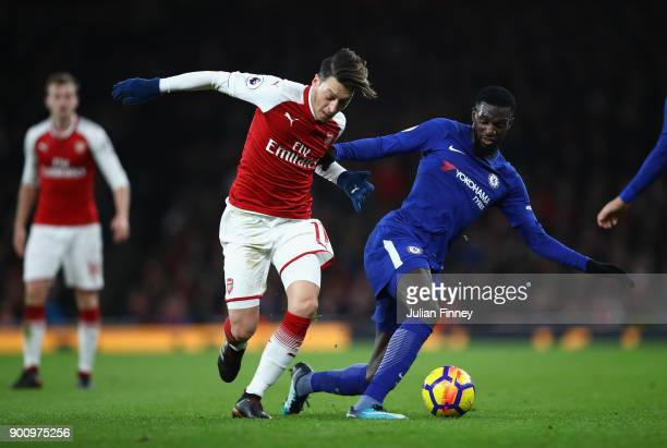 Mesut Ozil of Arsenal battles with Tiemoue Bakayoko of Chelsea during the Premier League match between Arsenal and Chelsea at Emirates Stadium on...