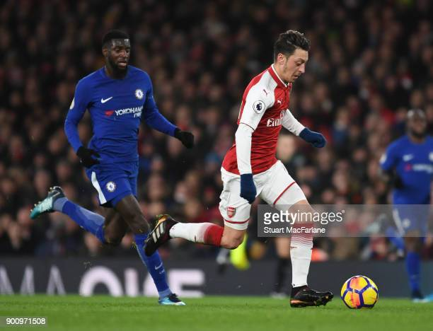 Mesut Ozil of Arsenal breaks past Tiemoue Bakayoko of Chelsea during the Premier League match between Arsenal and Chelsea at Emirates Stadium on...