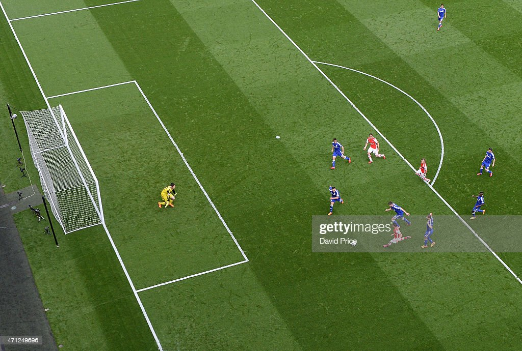 Mesut Ozil of Arsenal bursts into the box as the Chelsea defenders close in during the match between Arsenal and Chelsea in the Barclays Premier League at Emirates Stadium on April 26, 2015 in London, England.