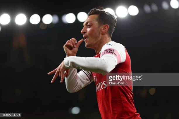 Mesut Ozil of Arsenal celebrates after he scores his sides first goal during the Premier League match between Arsenal FC and Leicester City at...