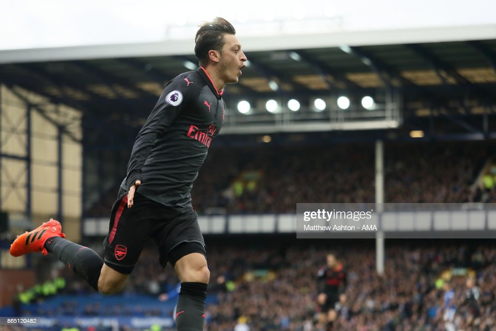 Mesut Ozil of Arsenal celebrates after scoring a goal to make it 1-2 during the Premier League match between Everton and Arsenal at Goodison Park on October 22, 2017 in Liverpool, England.