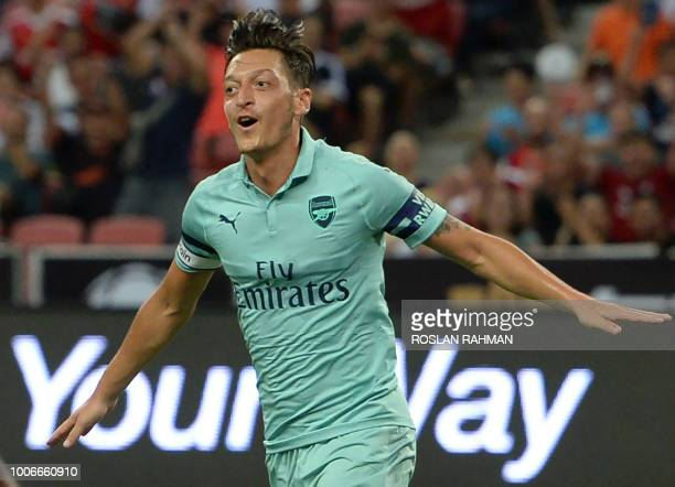 TOPSHOT Mesut Ozil of Arsenal celebrates after scoring during the International Champions Cup football match between Arsenal and Paris SaintGermain...
