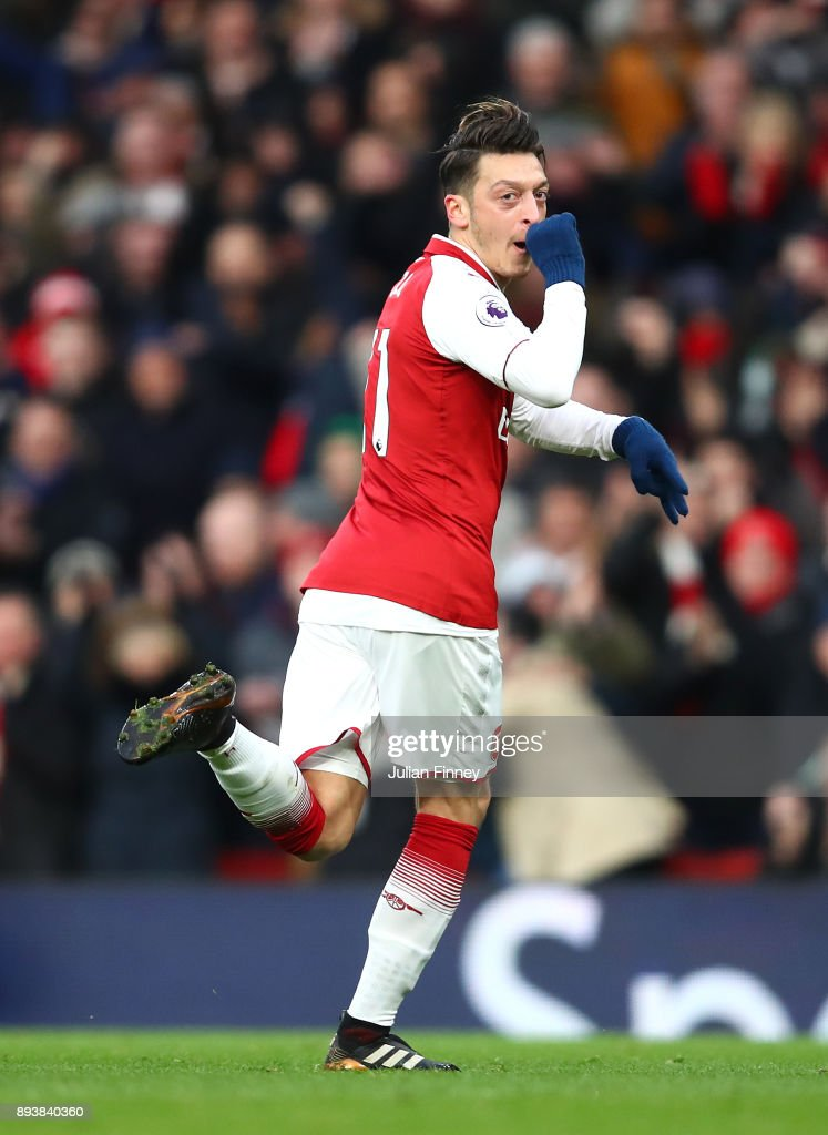 Mesut Ozil of Arsenal celebrates after scoring his sides first goal during the Premier League match between Arsenal and Newcastle United at Emirates Stadium on December 16, 2017 in London, England.