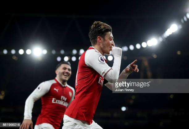 Mesut Ozil of Arsenal celebrates after scoring his sides fourth goal with Sead Kolasinac of Arsenal during the Premier League match between Arsenal...