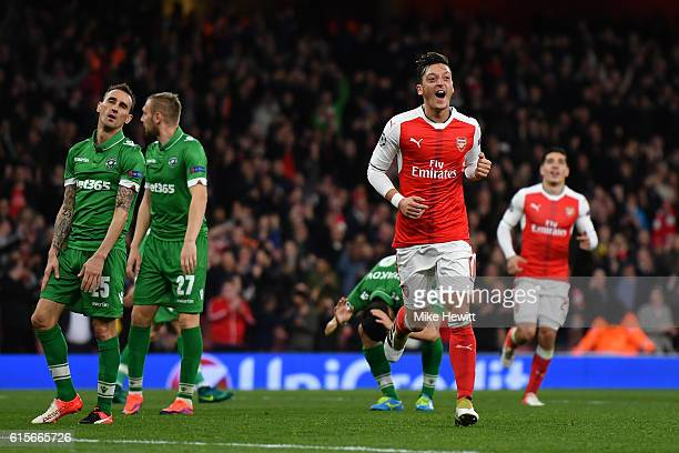 Mesut Ozil of Arsenal celebrates after scoring his third and his team's sixth goal of the game during the UEFA Champions League group A match between...