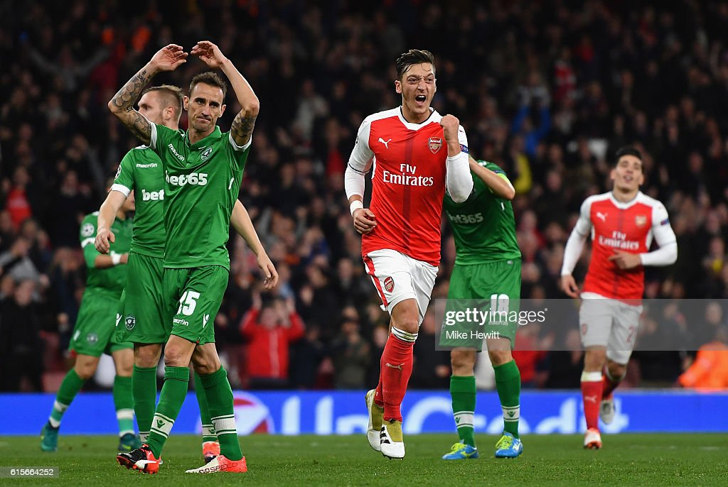 Mesut Ozil of Arsenal celebrates after scoring his thirs and his team's sixth goal of the game during the UEFA Champions League group A match between Arsenal FC and PFC Ludogorets Razgrad at the Emirates Stadium on October 19, 2016 in London, England.