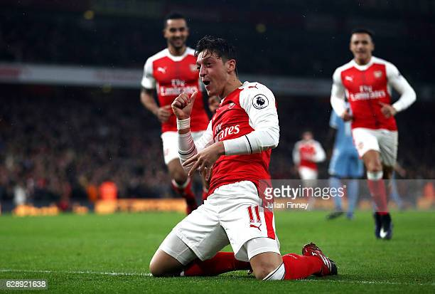 Mesut Ozil of Arsenal celebrates scoring his sides first goal during the Premier League match between Arsenal and Stoke City at the Emirates Stadium...