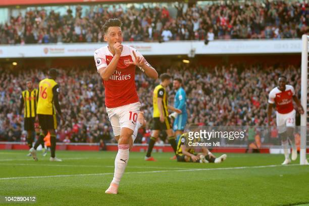 Mesut Ozil of Arsenal celebrates scoring his sides second goal during the Premier League match between Arsenal FC and Watford FC at Emirates Stadium...