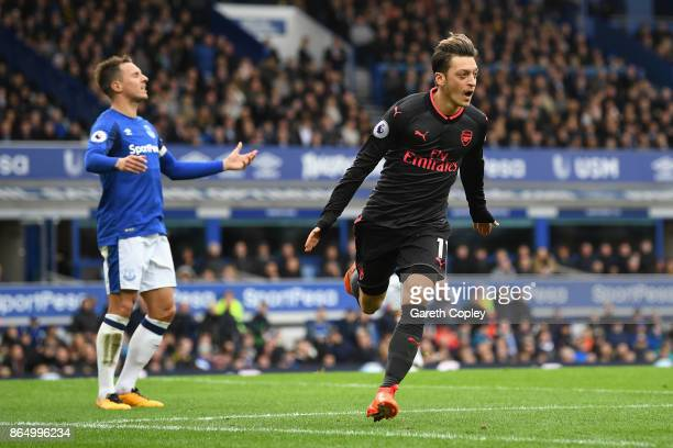 Mesut Ozil of Arsenal celebrates scoring his sides second goal during the Premier League match between Everton and Arsenal at Goodison Park on...