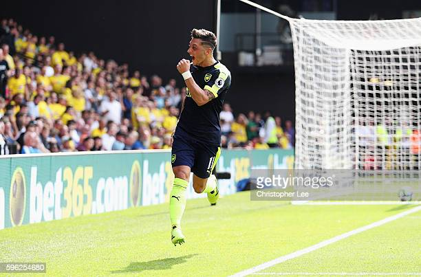 Mesut Ozil of Arsenal celebrates scoring his sides third goal during the Premier League match between Watford and Arsenal at Vicarage Road on August...