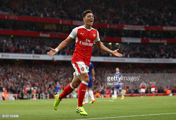 Mesut Ozil of Arsenal celebrates scoring his sides third goal during the Premier League match between Arsenal and Chelsea at the Emirates Stadium on...