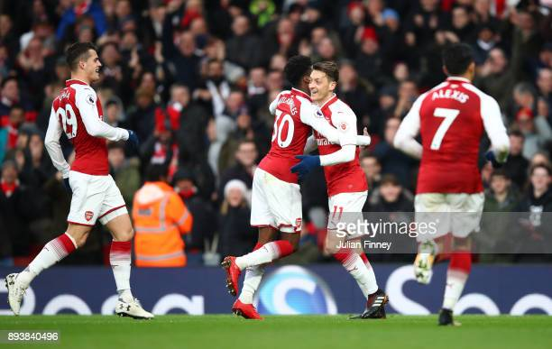 Mesut Ozil of Arsenal celebrates with Ainsley MaitlandNiles of Arsenal after scoring his sides first goal during the Premier League match between...