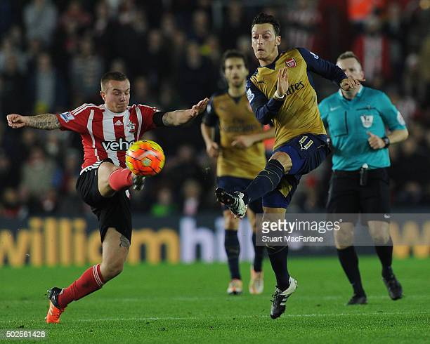 Mesut Ozil of Arsenal challenged by Jordy Clasie of Southampton during the Barclays Premier League match between Southampton and Arsenal at St Mary's...