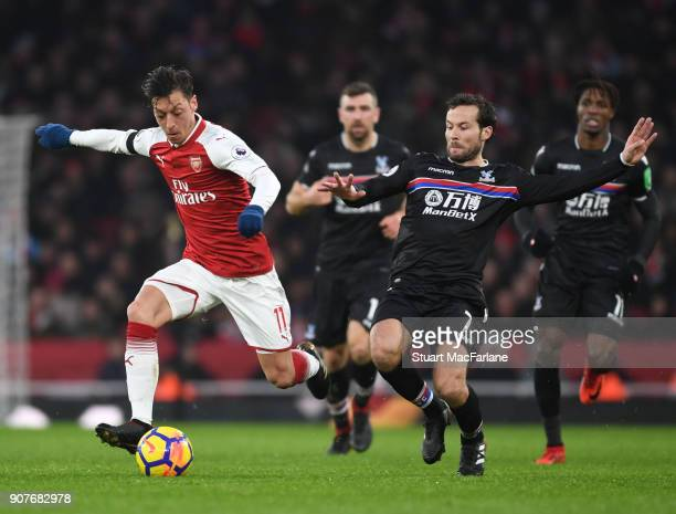 Mesut Ozil of Arsenal challenged by Yohan Cabaye of Crystal Palace during the Premier League match between Arsenal and Crystal Palace at Emirates...