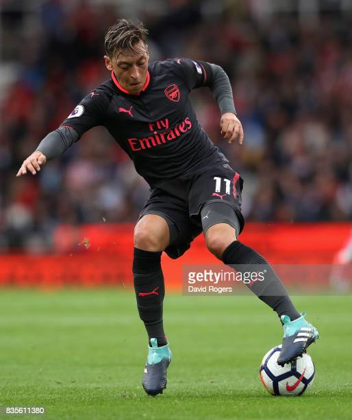 Mesut Ozil of Arsenal controls the ball during the Premier League match between Stoke City and Arsenal at Bet365 Stadium on August 19 2017 in Stoke...