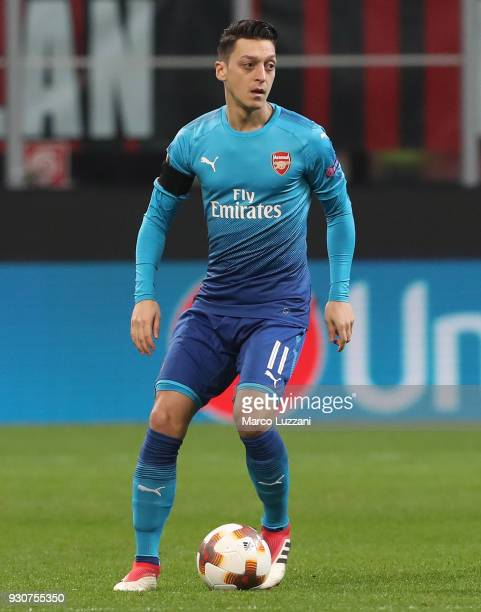 Mesut Ozil of Arsenal FC in action during UEFA Europa League Round of 16 match between AC Milan and Arsenal at the San Siro on March 8 2018 in Milan...