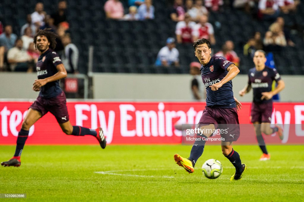 Mesut Ozil of Arsenal FC runs with the ball during the Pre-season friendly between Arsenal and SS Lazio at Friends Arena on August 4, 2018 in Stockholm, Sweden.
