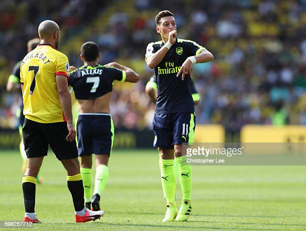 Mesut Ozil of Arsenal gesutres to the Arsenal fans during the Premier League match between Watford and Arsenal at Vicarage Road on August 27 2016 in...