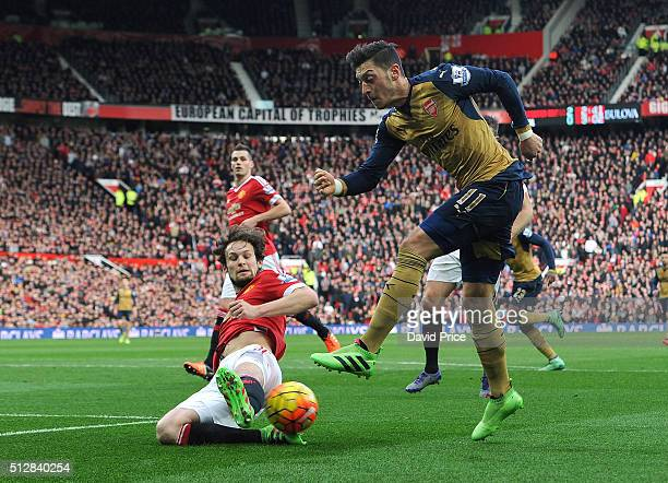 Mesut Ozil of Arsenal has his cross blocked by Daley Blind of Man Utd during the Barclays Premier League match between Manchester United and Arsenal...