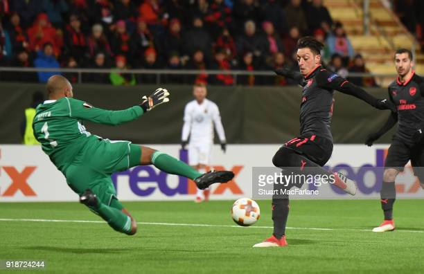 Mesut Ozil of Arsenal has his shot saved by Ostersund goalkeeper Aly Keita during UEFA Europa League Round of 32 match between Ostersunds FK and...