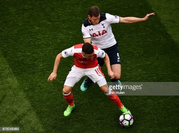 Mesut Ozil of Arsenal holds off Jan Vertonghen of Tottenham Hotspur during the Premier League match between Tottenham Hotspur and Arsenal at White...