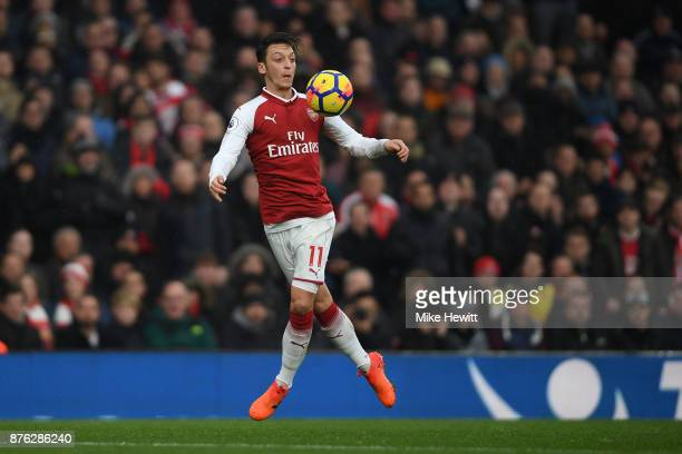 Mesut Ozil of Arsenal in action during the Premier League match between Arsenal and Tottenham Hotspur at Emirates Stadium on November 18 2017 in...