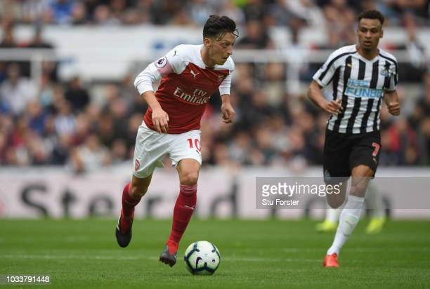 Mesut Ozil of Arsenal in action during the Premier League match between Newcastle United and Arsenal FC at St James Park on September 15 2018 in...