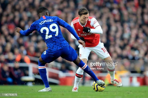 Mesut Ozil of Arsenal in action with Fikayo Tomori of Chelsea during the Premier League match between Arsenal FC and Chelsea FC at Emirates Stadium...