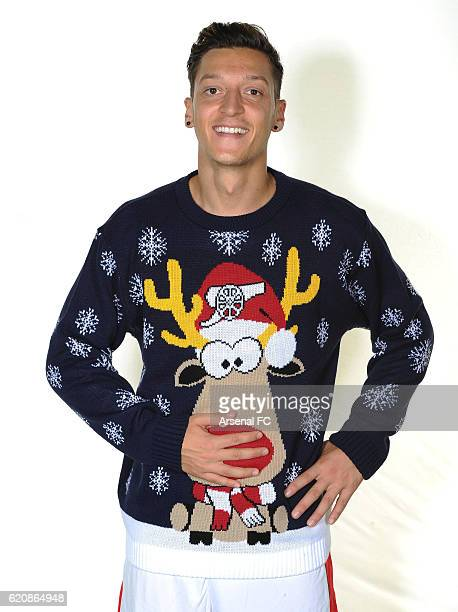 Mesut Ozil of Arsenal in his Arsenal Christmas Jumper to support Save the Children Christmas Jumper Day at London Colney on October 21 2016 in St...