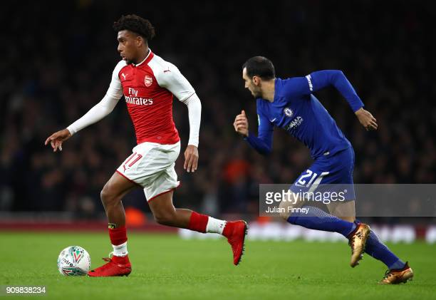 Mesut Ozil of Arsenal is chased by Davide Zappacosta of Chelsea during the Carabao Cup SemiFinal Second Leg at Emirates Stadium on January 24 2018 in...