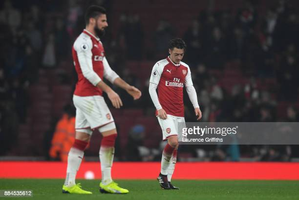 Mesut Ozil of Arsenal look dejected after the Premier League match between Arsenal and Manchester United at Emirates Stadium on December 2 2017 in...