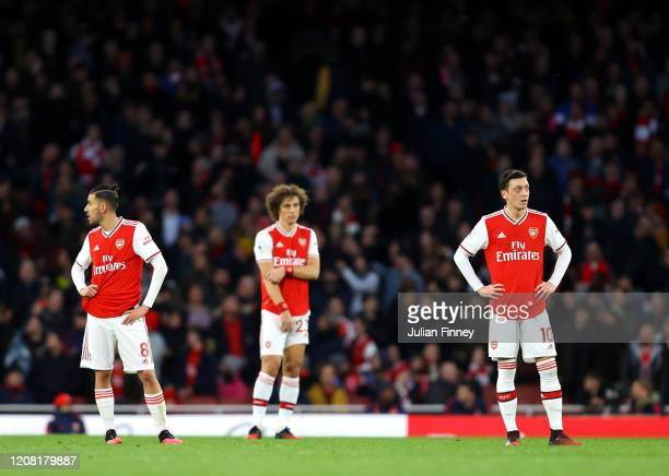 Mesut Ozil of Arsenal looks dejected after Richarlison of Everton scores his team's second goal during the Premier League match between Arsenal FC...