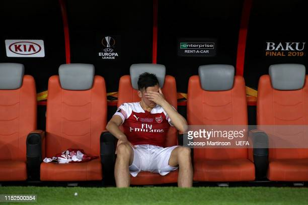 Mesut Ozil of Arsenal looks dejected from the bench following his team's defeat in the UEFA Europa League Final between Chelsea and Arsenal at Baku...