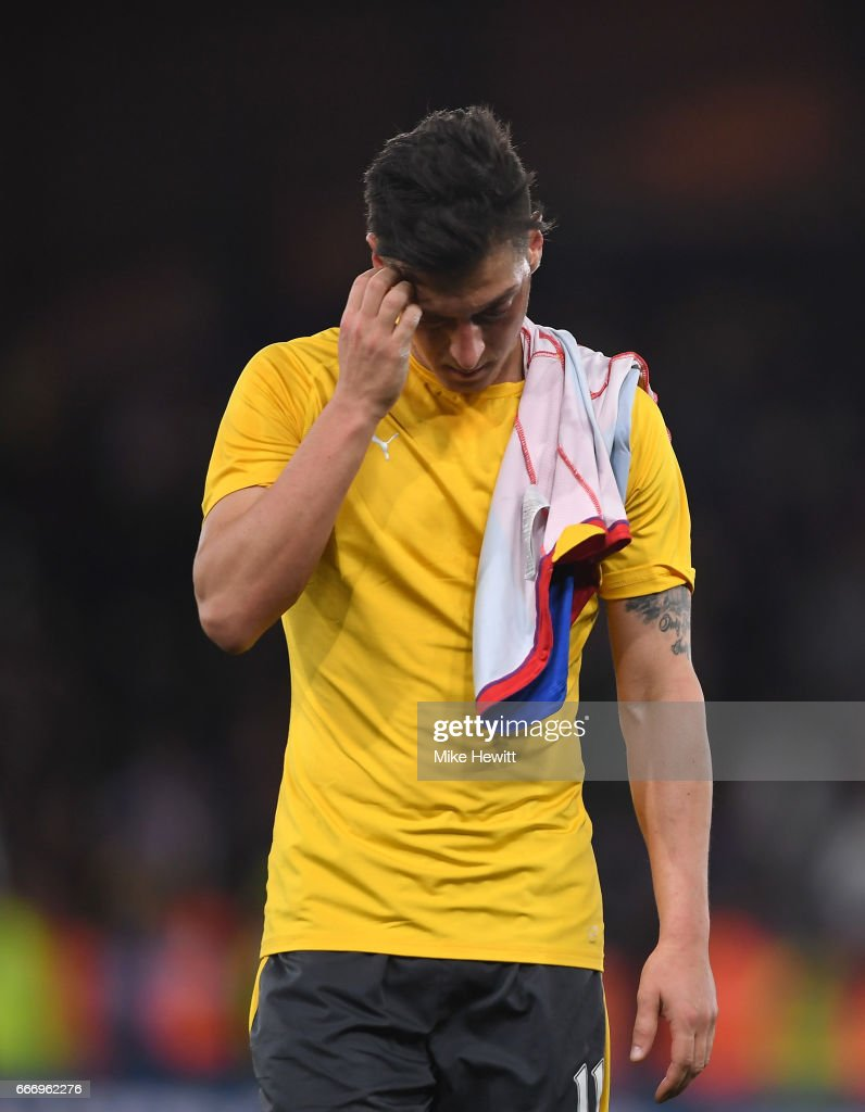 Mesut Ozil of Arsenal looks dejected in defeat after the Premier League match between Crystal Palace and Arsenal at Selhurst Park on April 10, 2017 in London, England.