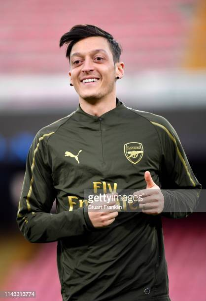 Mesut Ozil of Arsenal looks on during an Arsenal training session ahead of their UEFA Europa League quarterfinal second leg match against SSC Napoli...