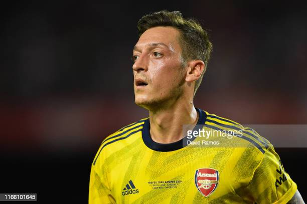 Mesut Ozil of Arsenal looks on during the Joan Gamper trophy friendly match between FC Barcelona and Arsenal at Nou Camp on August 04 2019 in...